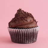 Cupcake. On pink background with frosting Royalty Free Stock Photo