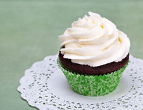 Cupcake. A cute chocolate cupcake with vanilla icing and copy space stock images