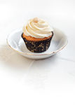 Cupcake. With macadamia nut on top of frosting Stock Photos