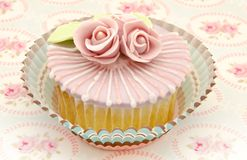Cupcake. Two cupcakes decorated with pink flower on a tablecloth Stock Photo