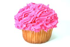 Cupcake. With pink decorative frosting.  Isolated on white background Royalty Free Stock Photo