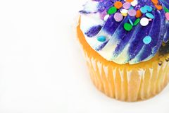 Cupcake. With purple frosting royalty free stock photos
