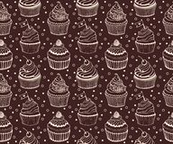 Cupcake baking seamless hand drawn pattern on the  Stock Images