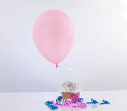 Cupcake with balloon on white background Royalty Free Stock Photography