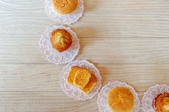 2 Cupcake 2 Banana Cupcake Garlic Bread on White Wooden Table stock photos