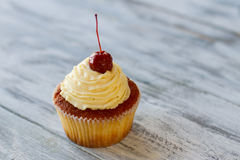 Cupcake with beige cream. Royalty Free Stock Photo