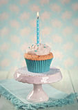 Cupcake with a birthday candle Royalty Free Stock Images