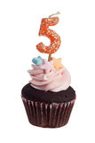 Cupcake with birthday candle for five year old Stock Photos