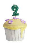 Cupcake with birthday candle for two year old Royalty Free Stock Photos