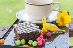 Cupcake on black plate Royalty Free Stock Images