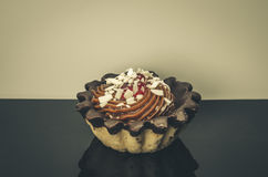 Cupcake on a black table. With a white background Stock Photos