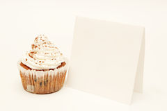 Cupcake with blank card Royalty Free Stock Image