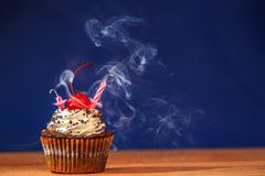 Cupcake with blown out candles on top Royalty Free Stock Image