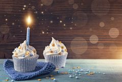 Cupcake with a blue candle. For birthday Royalty Free Stock Images