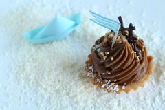 Cupcake with blue flag Stock Images