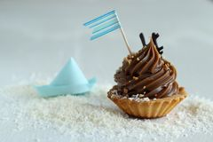 Cupcake with blue flag Stock Photo