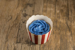 Cupcake with Blue Frosting Royalty Free Stock Photography