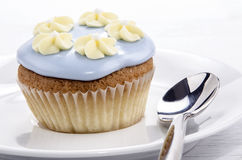 Cupcake with blue icing decoration Royalty Free Stock Image