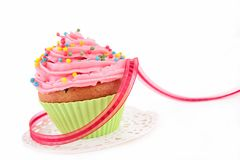 Cupcake and bow Stock Photos
