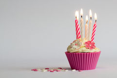 Cupcake with buning candles Stock Photos