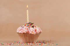 Cupcake with the burning festive candle Stock Photography
