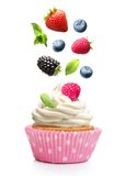 Cupcake  with butter cream and falling strawberry Stock Images