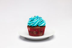 Cupcake with butter cream icing on the saucer. Stock Photography