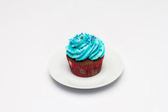 Cupcake with butter cream icing on the saucer. Royalty Free Stock Photography