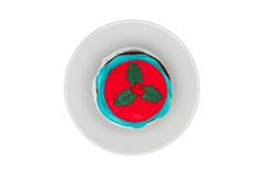 Cupcake with butter cream icing on the saucer. Christmas Royalty Free Stock Photography