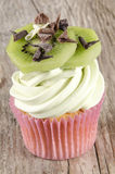 Cupcake with butter cream and kiwi slices Royalty Free Stock Photography