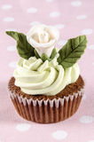 Cupcake with butter cream and white rose Stock Photos