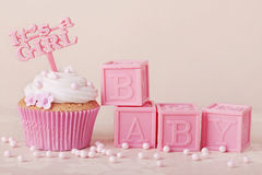 Cupcake with a cake pick Royalty Free Stock Photos