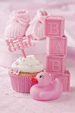 Cupcake with a cake pick Stock Image