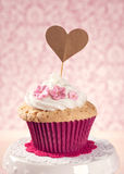 Cupcake with a cakepick Stock Images