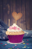 Cupcake with a cakepick Royalty Free Stock Images