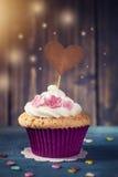 Cupcake with a cakepick Stock Photos