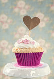 Cupcake with a cakepick Royalty Free Stock Photography