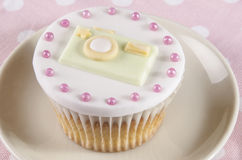 Cupcake with camera made from fondant Royalty Free Stock Photos