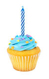 Cupcake With Candle. A cupcake with a birthday candle isolated on a white background Stock Photos