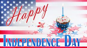 Cupcake with candle on american independence day. Independence day, celebration and holidays concept - close up of glazed cupcake or muffin with burning candle stock photos