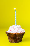 Cupcake with candle. On color background Royalty Free Stock Photos