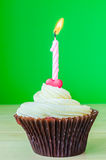Cupcake with candle. On color background Royalty Free Stock Photography
