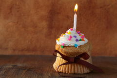 Cupcake with candle and  cream Royalty Free Stock Photography