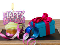 Cupcake with candle happy birthday and gift box Royalty Free Stock Photos