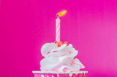 Cupcake. With candle on top on color background Royalty Free Stock Photos
