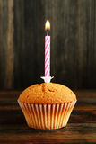 Cupcake with candle Royalty Free Stock Image