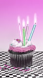 Cupcake with Candles Royalty Free Stock Photography