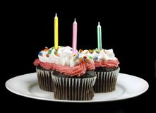 Cupcake with Candles on Black Stock Photo