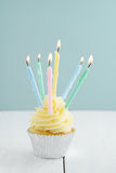 Cupcake with candles Royalty Free Stock Photo