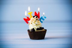 Cupcake with a candles for 9 - ninth birthday Royalty Free Stock Photography